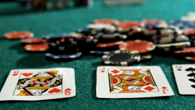 A stock photo of gambling chips and cards being distributed via wftv.com