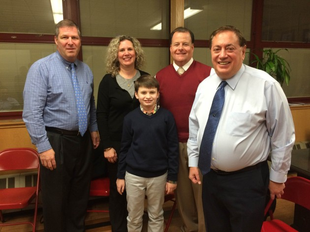 Michael Guasconi, second to right, with Superintendent of Schools George Solter (far left), his wife, son and Mayor Nick Sacco. Photo courtesy of Vision Media.