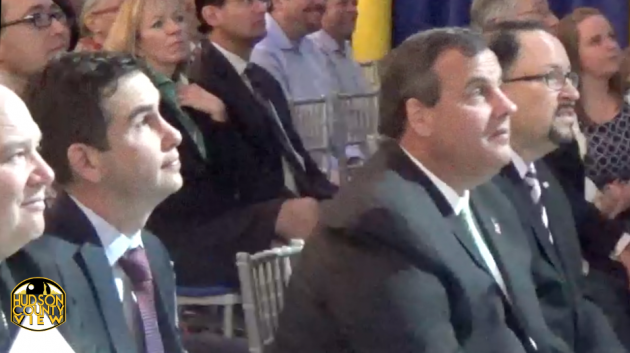 Jersey City Mayor Steven Fulop and Gov. Chris Christie sit next to each other during the Goya grand opening on April 29, 2015.