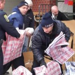 Hoboken Police and Fire Departments distribute 150 Thanksgiving meals