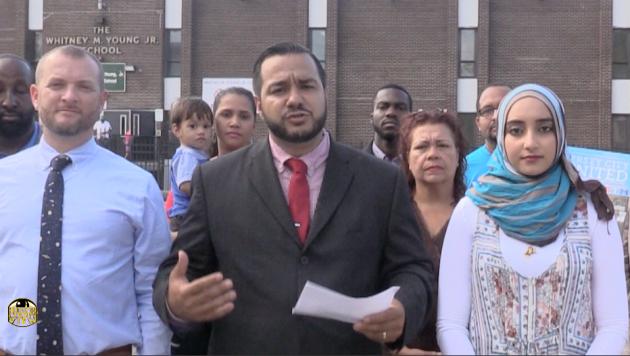 Luis Felipe Fernandez (middle) speaks at a press event in October.