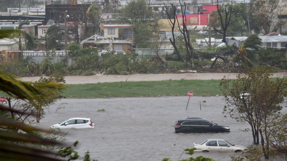 A parking lot is flooded near Roberto Clemente Coliseum in San Juan, Puerto Rico, on September 20, 2017, during Hurricane Maria. Photo by Hector Retamal/AFP/Getty Images.