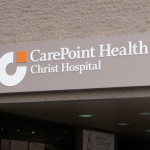 1st COVID-19 death at Christ Hospital confirmed, 2 under investigation, Fulop says